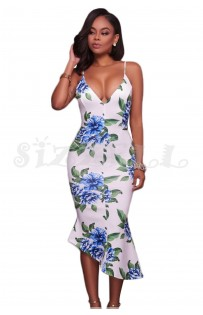 "THE ""LIZ"" LUXE FLORAL DRESS W/ ANGLED HEM.."